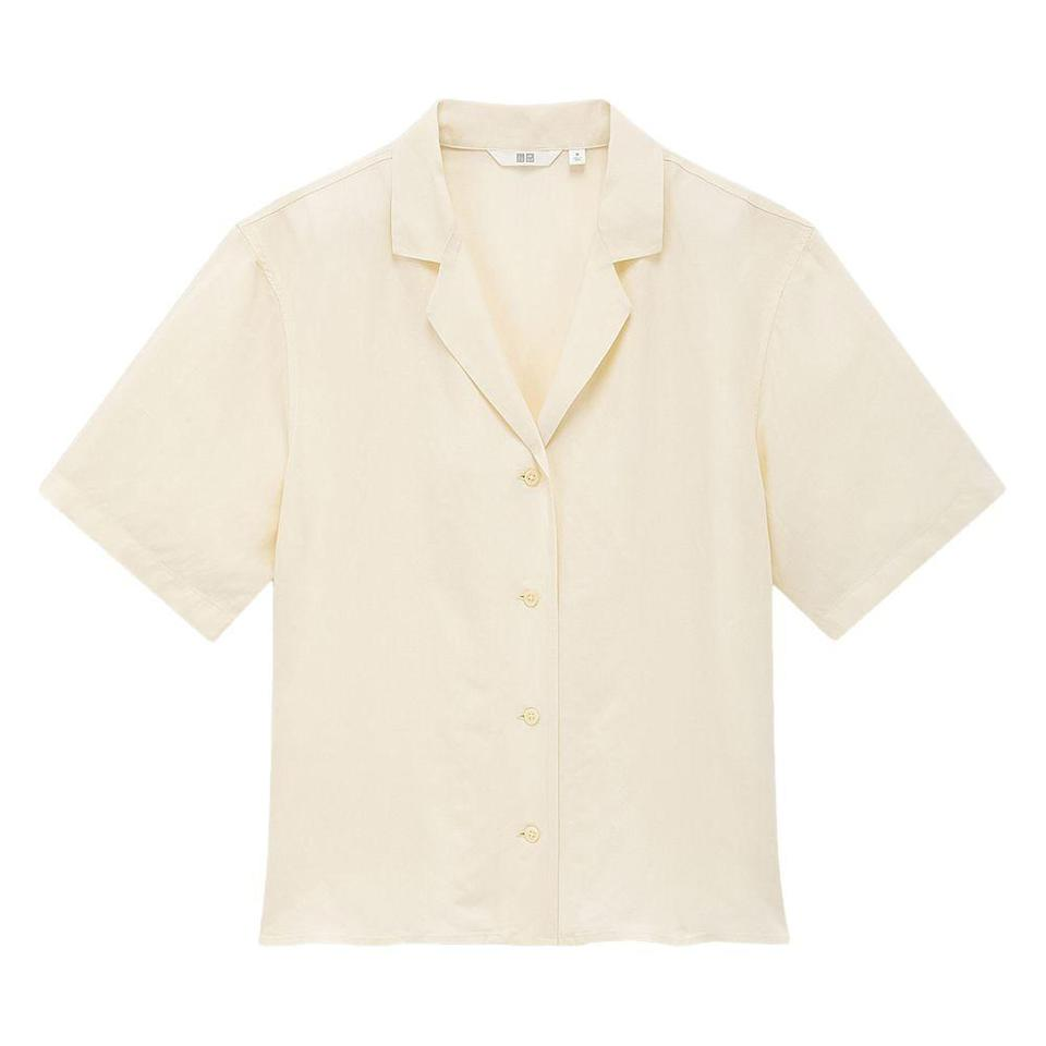 """<p><strong>Uniqlo</strong></p><p>uniqlo.com</p><p><strong>$29.90</strong></p><p><a href=""""https://go.redirectingat.com?id=74968X1596630&url=https%3A%2F%2Fwww.uniqlo.com%2Fus%2Fen%2Fwomen-linen-blend-short-sleeve-shirt-425468COL01SMA004000.html&sref=https%3A%2F%2Fwww.elle.com%2Ffashion%2Fshopping%2Fg36831494%2Ftravel-gift-ideas%2F"""" rel=""""nofollow noopener"""" target=""""_blank"""" data-ylk=""""slk:Shop Now"""" class=""""link rapid-noclick-resp"""">Shop Now</a></p><p>No matter the weather report, this linen-blend shirt will go with everything in their suitcase. </p>"""