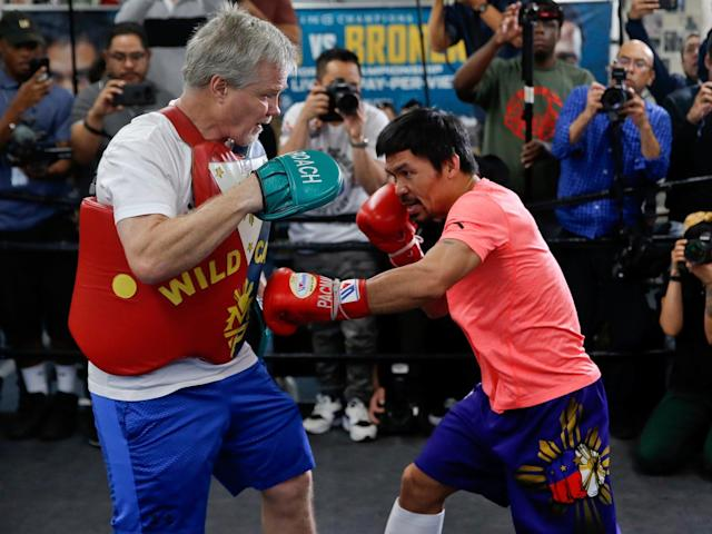 Freddie Roach and Manny Pacquiao have reunited ahead of the Filipino senator's title defense vs. Adrien Broner. (AP)