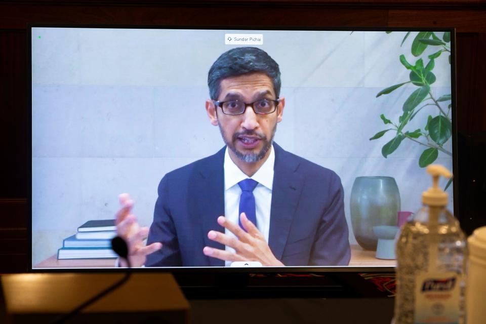 CEO of Alphabet Inc. and its subsidiary Google LLC, Sundar Pichai, appears on a monitor as he testifies remotely during a hearing to discuss reforming Section 230 of the Communications Decency Act with big tech companies on October 28, 2020 in Washington, DC. - US senators and tech CEOs girded for a clash Wednesday over a law making online services immune from liability for third-party content at a hearing set to debate Silicon Valley's handling of social media. (Photo by MICHAEL REYNOLDS / POOL / AFP) (Photo by MICHAEL REYNOLDS/POOL/AFP via Getty Images)