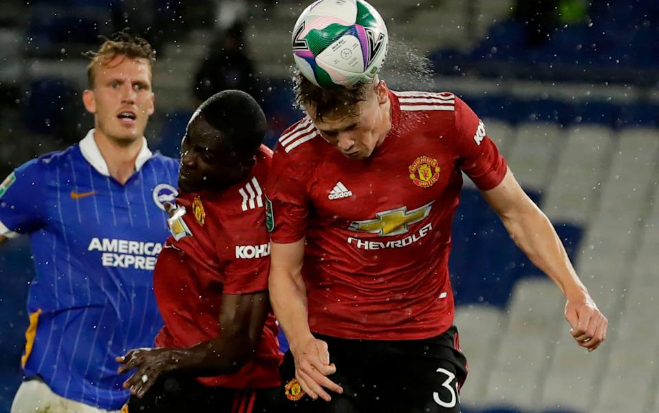 Manchester United midfielder Scott McTominay heads the ball - AFP