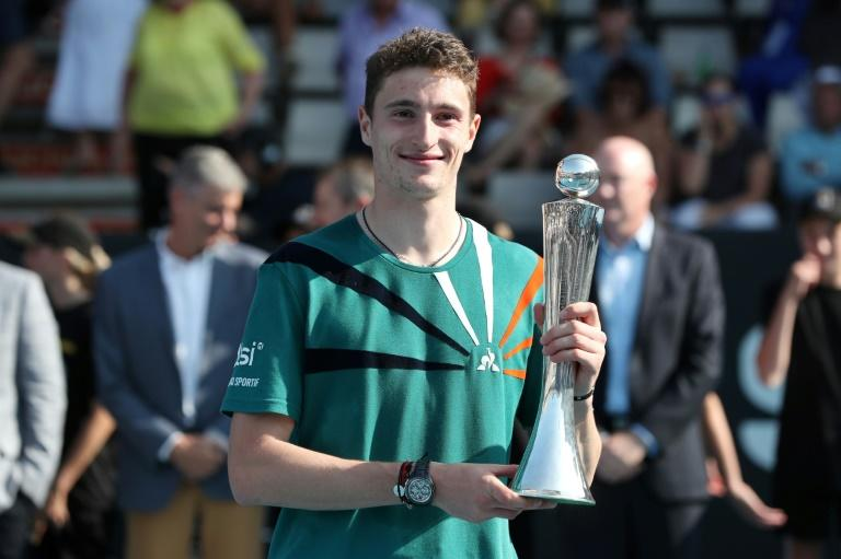 The unseeded Ugo Humbert held his nerve in the deciding tie-break of his first ATP final to win against Benoit Paire