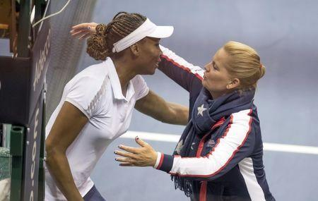 Feb 10, 2018; Asheville, NC, USA; Venus Williams (USA) and Team captain Kathy Rinaldi hug after Venus records matchpoint in her match against Arantxa Rus (NED, not pictured) during the Fed Cup tie at U.S. Cellular Center. Susan Mullane-USA TODAY Sports