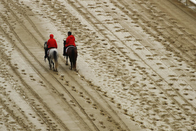 <p>Outriders walk on the track before the 144th running of the Kentucky Derby horse race at Churchill Downs Saturday, May 5, 2018, in Louisville, Ky. (Photo: Charlie Riedel/AP) </p>
