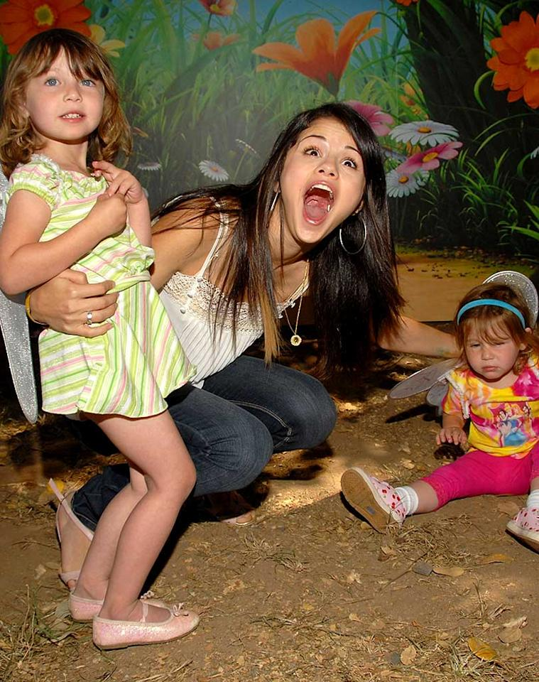 """Wizards of Waverly Place"" star Selena Gomez has her hands full with two tykes. Lester Cohen/<a href=""http://www.wireimage.com"" target=""new"">WireImage.com</a> - June 8, 2008"