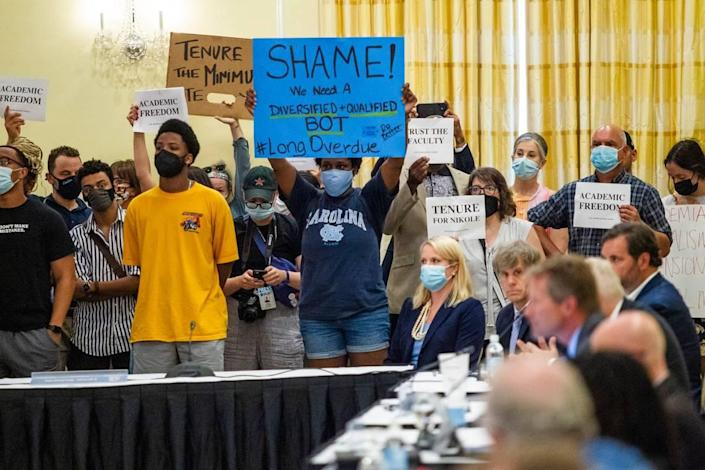 Demonstrators protest at a UNC-Chapel Hill trustees meeting Wednesday, June, 30, 2021 as the board prepared to discuss and vote on tenure for distinguished journalist Nikole Hannah-Jones.