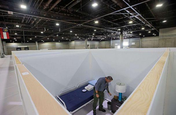 PHOTO: Georgia Emergency Management Agency employees Mike Engleking inspects a room at a 120-bed Alternate Care Facility for coronavirus patients, inside the Georgia World Congress Center in Atlanta, July 24, 2020. (Erik S Lesser/EPA via Shutterstock)