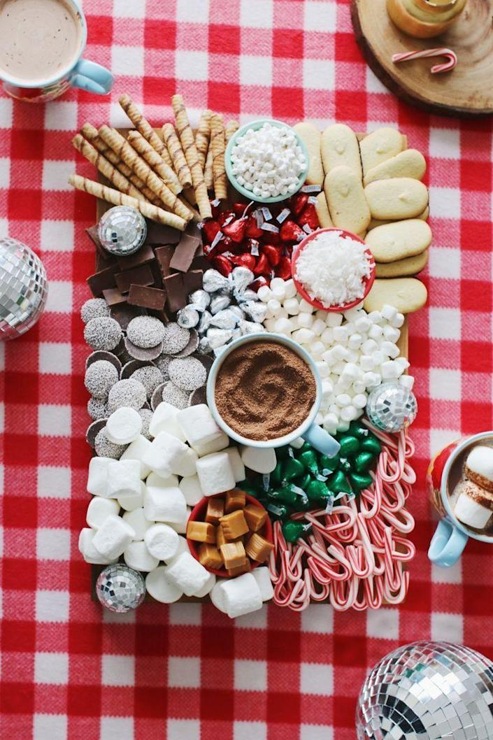 """<p>This clever DIY hot chocolate board makes a great snow day activity or Christmas morning treat. Fill up the board with all your favorite fixin's—marshmallows, candy, cookies, and more! </p><p><a href=""""https://www.thepioneerwoman.com/food-cooking/a34847673/hot-chocolate-board/"""" rel=""""nofollow noopener"""" target=""""_blank"""" data-ylk=""""slk:Get the recipe."""" class=""""link rapid-noclick-resp""""><strong>Get the recipe.</strong></a></p>"""