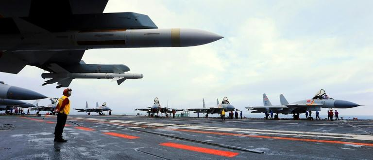 The drill included multiple take-offs by J-15 fighters from the deck of the Liaoning, Chinese state media said