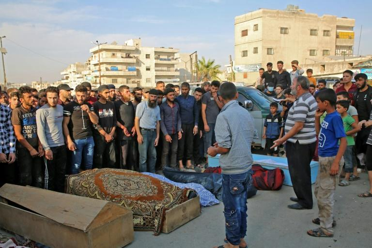 Syrians take part in the funeral of 10 fighters with the Turkey-backed Faylaq al-Sham rebel faction in Syria, in the northwestern city of Idlib, on October 26, 2020, following their death in a Russian air strike