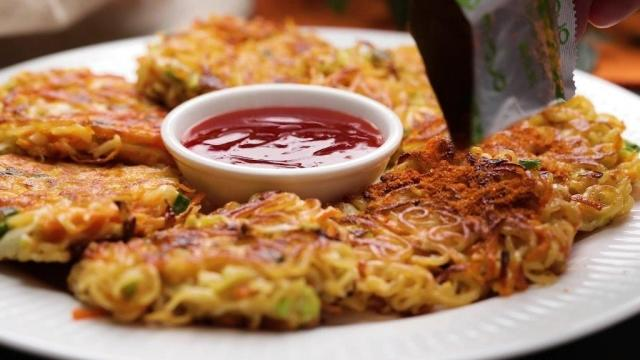 dusting instant noodle pancakes with seasoning