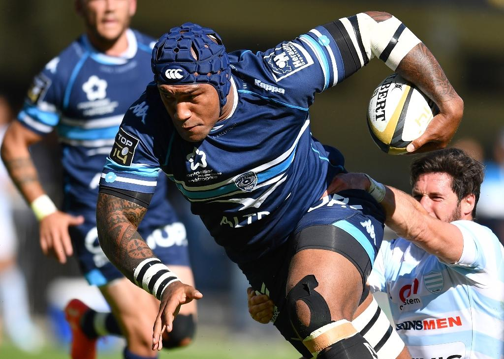 Montpellier's Fijian winger Nemani Nadolo (C) runs with the ball (AFP Photo/PASCAL GUYOT)