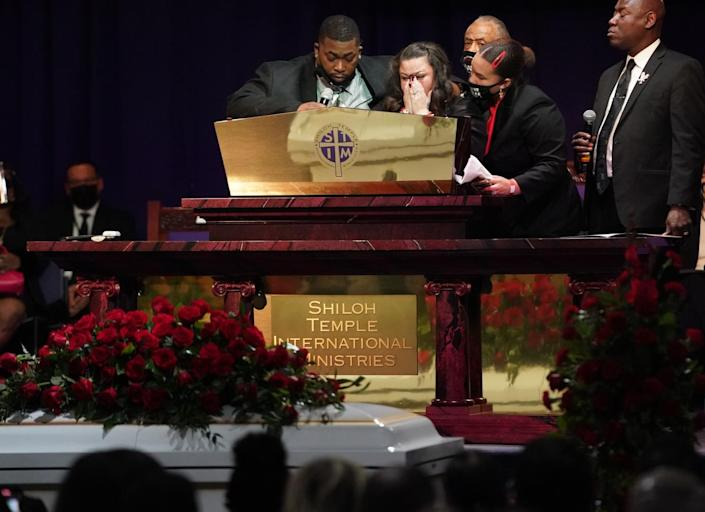 Katie Wright, mother of Daunte Wright, center, at her sons funeral.