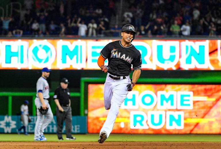 Giancarlo Stanton of the Miami Marlins hits the go ahead homerun in the eighth inning during their game against the New York Mets, at Marlins Park in Miami, Florida, on April 15, 2017