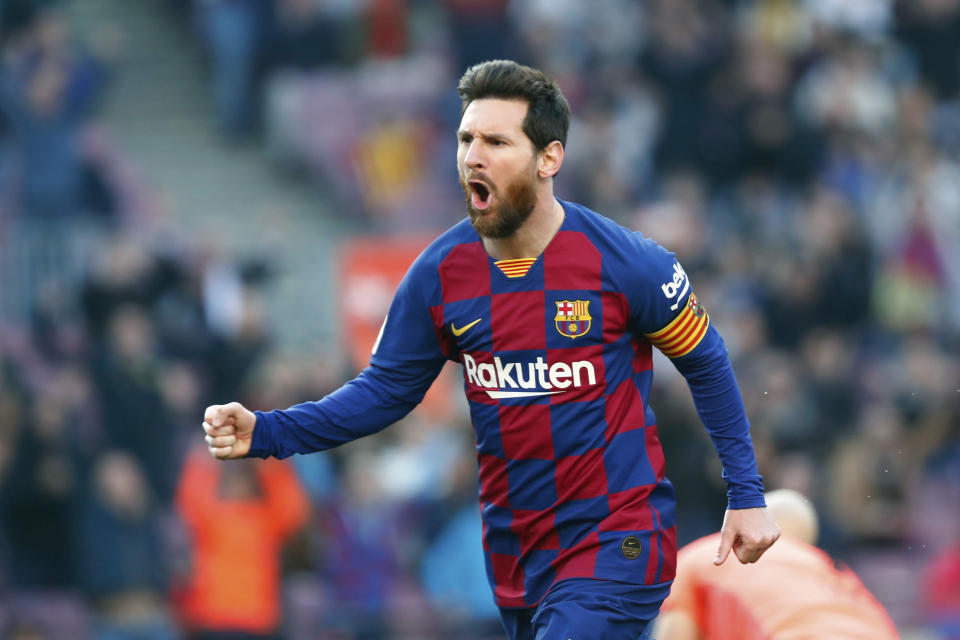 FILE - In this Saturday, Feb. 22, 2020 file photo, Barcelona's Lionel Messi celebrates after scoring his side's opening goal during a Spanish La Liga soccer match between Barcelona and Eibar at the Camp Nou stadium in Barcelona, Spain. panish Prime Minister Pedro Sánchez announced Saturday, May 23, 2020 that the soccer league in Spain will be allowed to resume from June 8. While the top tier, La Liga, can play from this date, it has already said it wants to resume play on June 12. It is unclear when the first games will be held. There has been no play in the top tier since March 12 due to the coronavirus crisis. (AP Photo/Joan Monfort, File)