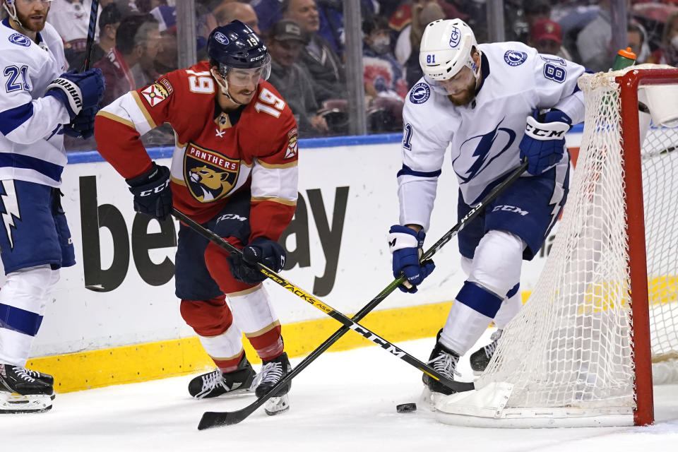 Florida Panthers left wing Mason Marchment (19) and Tampa Bay Lightning defenseman Erik Cernak (81) go for the puck during the second period in Game 5 of an NHL hockey Stanley Cup first-round playoff series, Monday, May 24, 2021, in Sunrise, Fla. (AP Photo/Lynne Sladky)