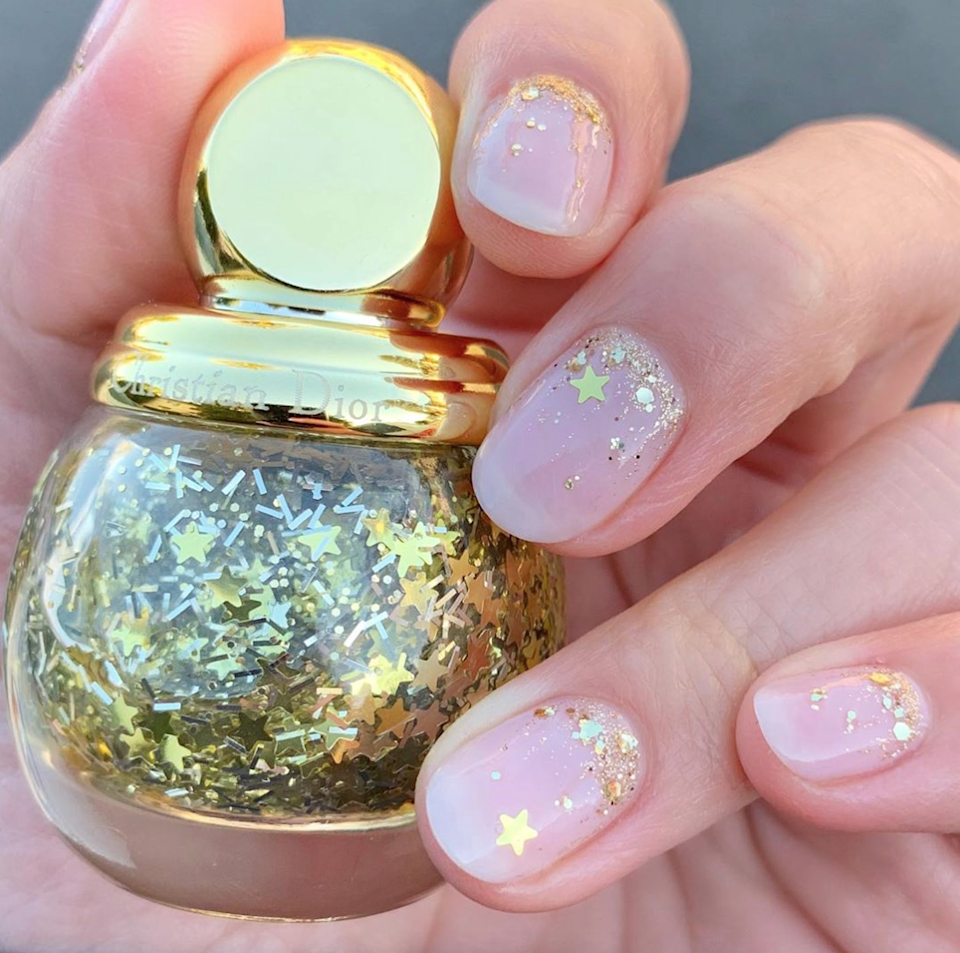 So cute we wish we could throw this out at midnight. Concentrating the sparkles at the base of your nails keeps things fresh and plays up the confetti effect.