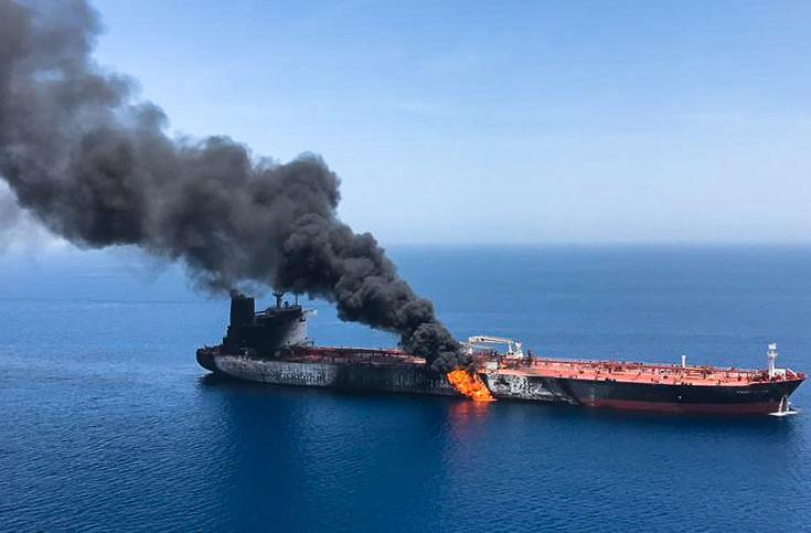 TOPSHOT - A picture obtained by AFP from Iranian News Agency ISNA on June 13, 2019 reportedly shows fire and smoke billowing from Norwegian owned Front Altair tanker said to have been attacked in the waters of the Gulf of Oman. - Suspected attacks left two tankers in flames in the waters of the Gulf of Oman today, sending world oil prices soaring as Iran helped rescue stricken crew members. The mystery incident, the second involving shipping in the strategic sea lane in only a few weeks, came amid spiralling tensions between Tehran and Washington, which has pointed the finger at Iran over earlier tanker attacks in May. (Photo by - / ISNA / AFP)        (Photo credit should read -/AFP/Getty Images)