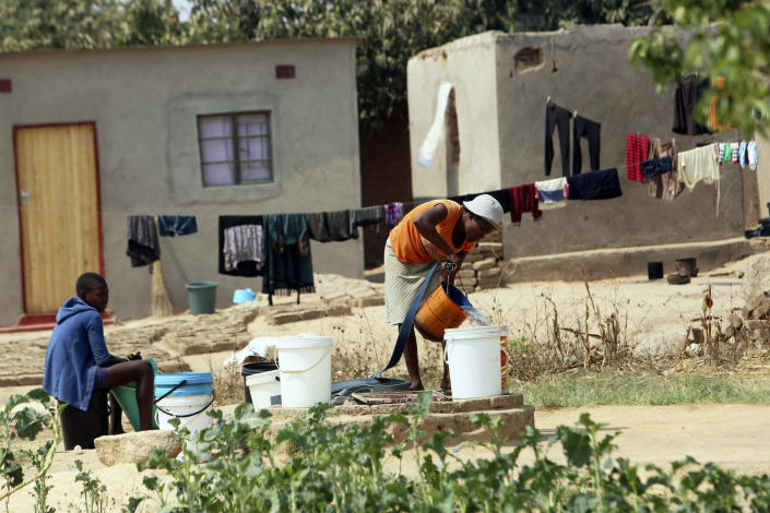 A woman fetchies water from a well in Harare, Tuesday, Sept, 24, 2019.The more than 2 million residents of Zimbabwes capital and surrounding towns are now without water after authorities shut down the citys main treatment plant, raising new fears about disease after a recent cholera outbreak while the economy crumbles further.(AP Photo/Tsvangirayi Mukwazhi)