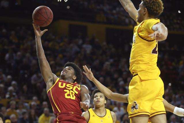 Southern California guard Ethan Anderson (20) drives past Arizona State guard Rob Edwards, middle, and forward Jalen Graham, right, during the first half of an NCAA college basketball game Saturday, Feb. 8, 2020, in Tempe, Ariz. (AP Photo/Ross D. Franklin)