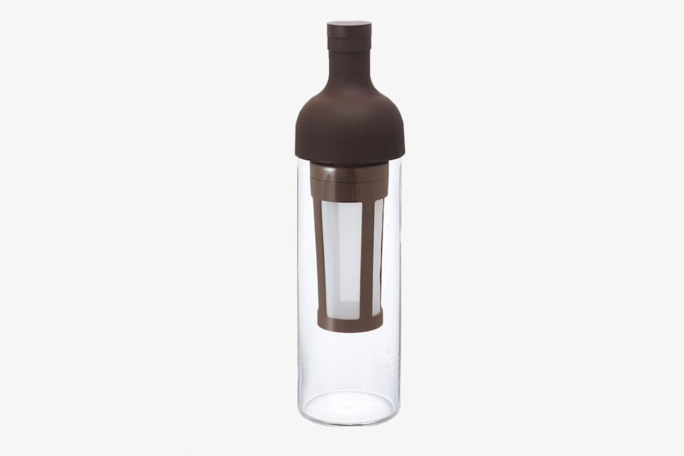 """Is the coffee lover in your life committed to cold brew, even in sub-zero temperatures? Then this Hario coffee bottle is a must-have. The wine-sized bottle makes five cups of cold brew in eight hours—they just have to fill the center mesh filter with their favorite grounds, add water, and let it sit overnight. The silicone spout on top simplifies pouring, while the glass is heat-proof and extra durable, should they want to bring the whole contraption along on their <a href=""""https://www.cntraveler.com/gallery/best-fall-vacations?mbid=synd_yahoo_rss"""" rel=""""nofollow noopener"""" target=""""_blank"""" data-ylk=""""slk:next trip"""" class=""""link rapid-noclick-resp"""">next trip</a>. $32, Amazon. <a href=""""https://www.amazon.com/Hario-FIC-70-MC-Brewed-Coffee-Mocha/dp/B00TF7WSVI/"""" rel=""""nofollow noopener"""" target=""""_blank"""" data-ylk=""""slk:Get it now!"""" class=""""link rapid-noclick-resp"""">Get it now!</a>"""