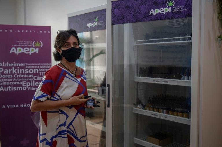 Brazilian lawyer and founder of the Medical Cannabis Research and Patient Support Association (Apepi) Margarete Brito shows a fridge containing medicinal cannabis oil at Apepi headquarters (AFP/MAURO PIMENTEL)