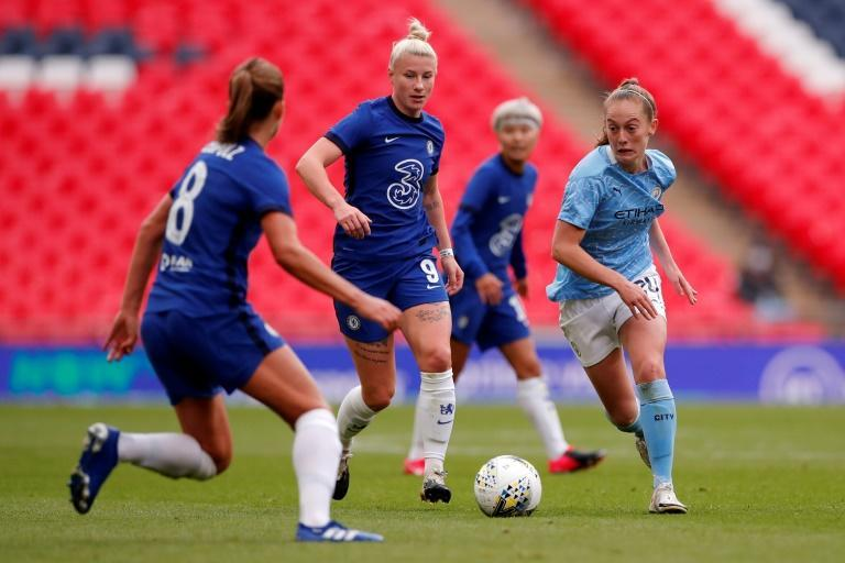 Chelsea striker Bethany England (centre) believes English clubs can become a dominant force in the women's Champions League