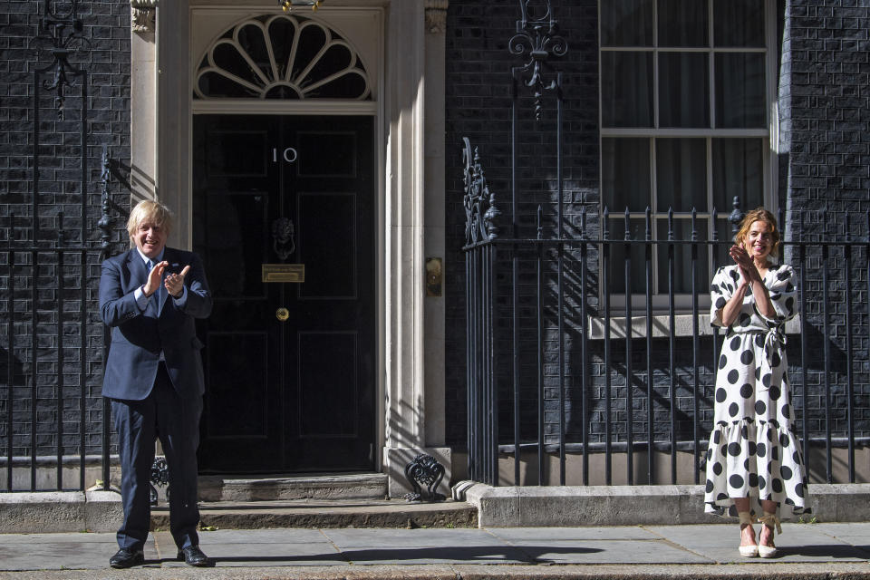 As part of the NHS birthday celebrations, Prime Minister, Boris Johnson and Annemarie Plas, founder of Clap For Our Carers, outside 10 Downing Street, London, join in the pause for applause to salute the NHS 72nd birthday.