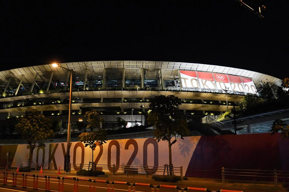 SHINJUKU, JAPAN - 2021/07/22: Tokyo Olympic Stadium seen on the eve of the opening ceremony. With just one day until the Olympics opening ceremony, Tokyo confirms 1,979 new coronavirus infections. The total number of cases in Tokyo now stands at 195,041. (Photo by Jinhee Masahiro Lee/SOPA Images/LightRocket via Getty Images)