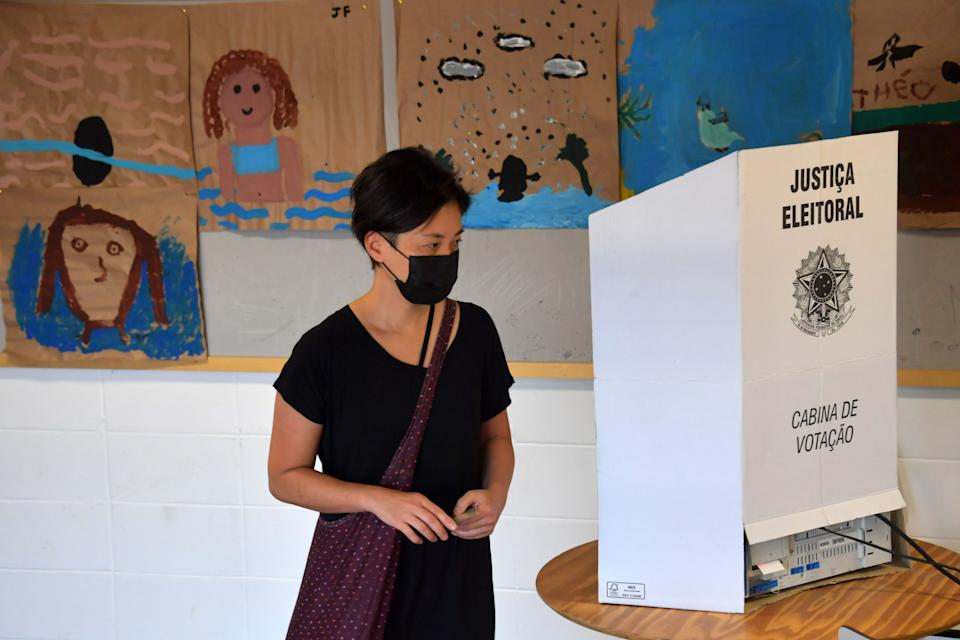 A woman votes at a polling station during the municipal election runoff in Sao Paulo, Brazil, on November 29 2020, amid the new coronavirus pandemic. - Brazilians go to the polls Sunday to chose mayors in 57 cities, including Sao Paulo and Rio de Janeiro, the most rich and populated, in a runoff marked by the economic crisis and an upsurge of the new coronavirus. (Photo by NELSON ALMEIDA / AFP) (Photo by NELSON ALMEIDA/AFP via Getty Images)