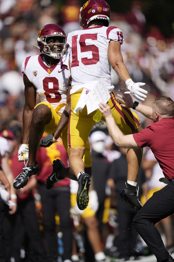 Southern California tight end Michael Trigg, left, and wide receiver Drake London celebrate after London's touchdown catch agianst Colorado in the first half of an NCAA college football game Saturday, Oct. 2, 2021, in Boulder, Colo. (AP Photo/David Zalubowski)