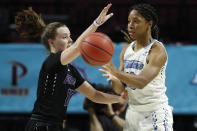 San Diego's Myah Pace (10) passes around Portland's Maddie Muhlheim (15) during the first half of an NCAA college basketball game in the final of the West Coast Conference women's tournament Tuesday, March 10, 2020, in Las Vegas. (AP Photo/John Locher)