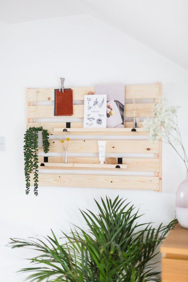 """<p>If you combine two shelves, you'll have a place to hang your keys that doubles as a mood board to showcase swatches, chic plants, and notes.</p><p>See more at <a href=""""https://www.hunker.com/13716578/from-simple-ikea-shelf-to-totally-genius-shelving-unit"""" rel=""""nofollow noopener"""" target=""""_blank"""" data-ylk=""""slk:hunker"""" class=""""link rapid-noclick-resp"""">hunker</a>. </p><p><a class=""""link rapid-noclick-resp"""" href=""""https://go.redirectingat.com?id=74968X1596630&url=https%3A%2F%2Fwww.ikea.com%2Fus%2Fen%2Fp%2Fhejne-shelf-softwood-80287809%2F%3Fgclid%3DEAIaIQobChMI5-GO_cWi4AIVxBx9Ch1kdwCVEAQYAiABEgJKOvD_BwE&sref=https%3A%2F%2Fwww.countryliving.com%2Fhome-maintenance%2Fg37186772%2Fentryway-ikea-hacks%2F"""" rel=""""nofollow noopener"""" target=""""_blank"""" data-ylk=""""slk:BUY NOW"""">BUY NOW</a> <em><strong>Henje</strong></em> <strong><em>Shelf, $14</em></strong></p>"""