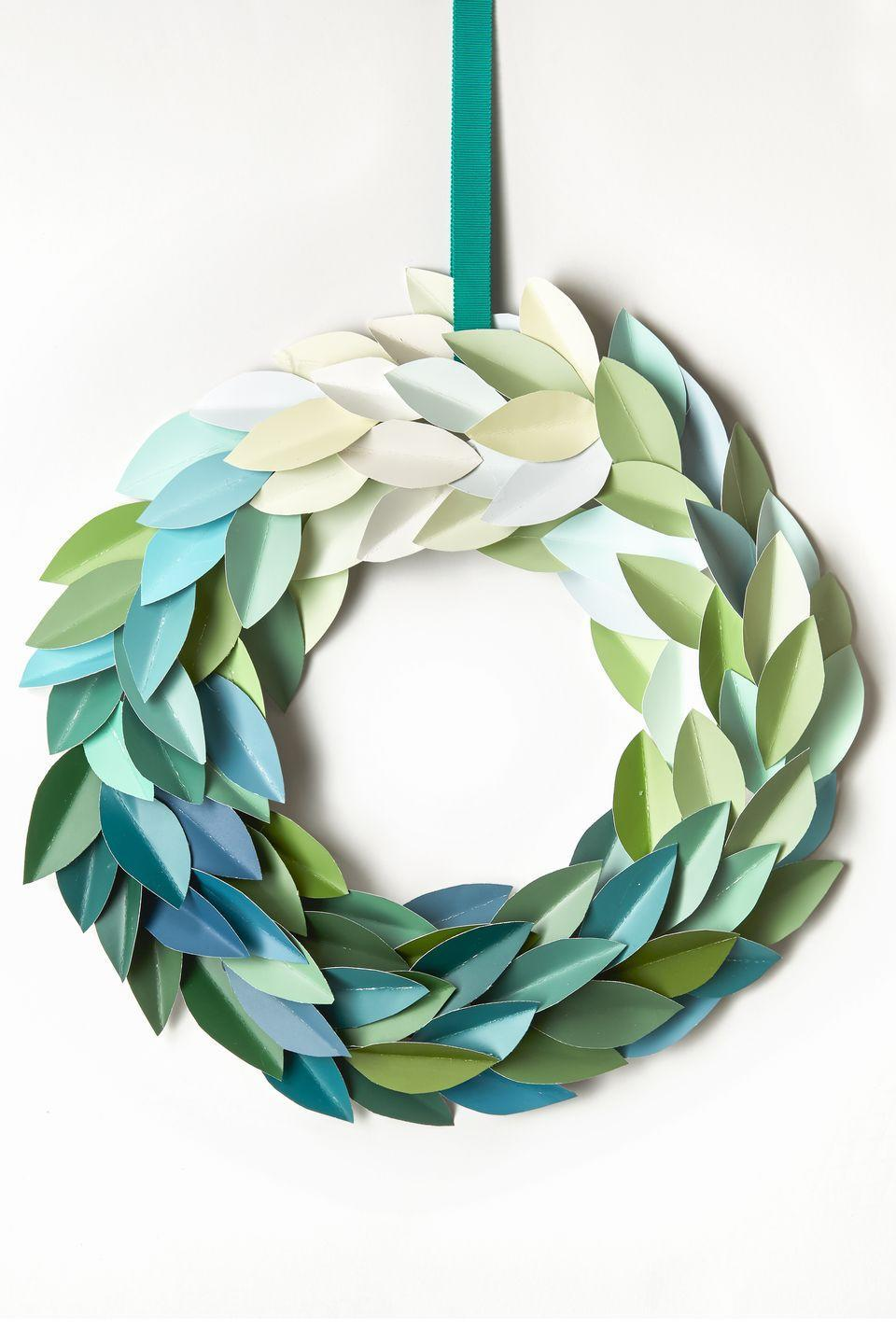 """<p>Snag 40 paint chips (usually free at the paint store) and grab a pair of scissors for this colorful DIY. Cut leaf shapes out of the swatches, crease them in the middle, hot-glue onto a <a href=""""https://www.amazon.com/FloraCraft-SimpleStyle-Wreath-Green-Gauge/dp/B00BTDBLE6/?tag=syn-yahoo-20&ascsubtag=%5Bartid%7C10055.g.2996%5Bsrc%7Cyahoo-us"""" rel=""""nofollow noopener"""" target=""""_blank"""" data-ylk=""""slk:wire wreath frame"""" class=""""link rapid-noclick-resp"""">wire wreath frame</a>, and voila: a door decoration that <em>won't </em>shed needles all over your stoop.</p><p><strong>RELATED:</strong> <a href=""""https://www.goodhousekeeping.com/home/craft-ideas/how-to/g814/paint-chip-crafts/"""" rel=""""nofollow noopener"""" target=""""_blank"""" data-ylk=""""slk:Clever Crafts to Make with Leftover Paint Chips"""" class=""""link rapid-noclick-resp"""">Clever Crafts to Make with Leftover Paint Chips</a></p>"""