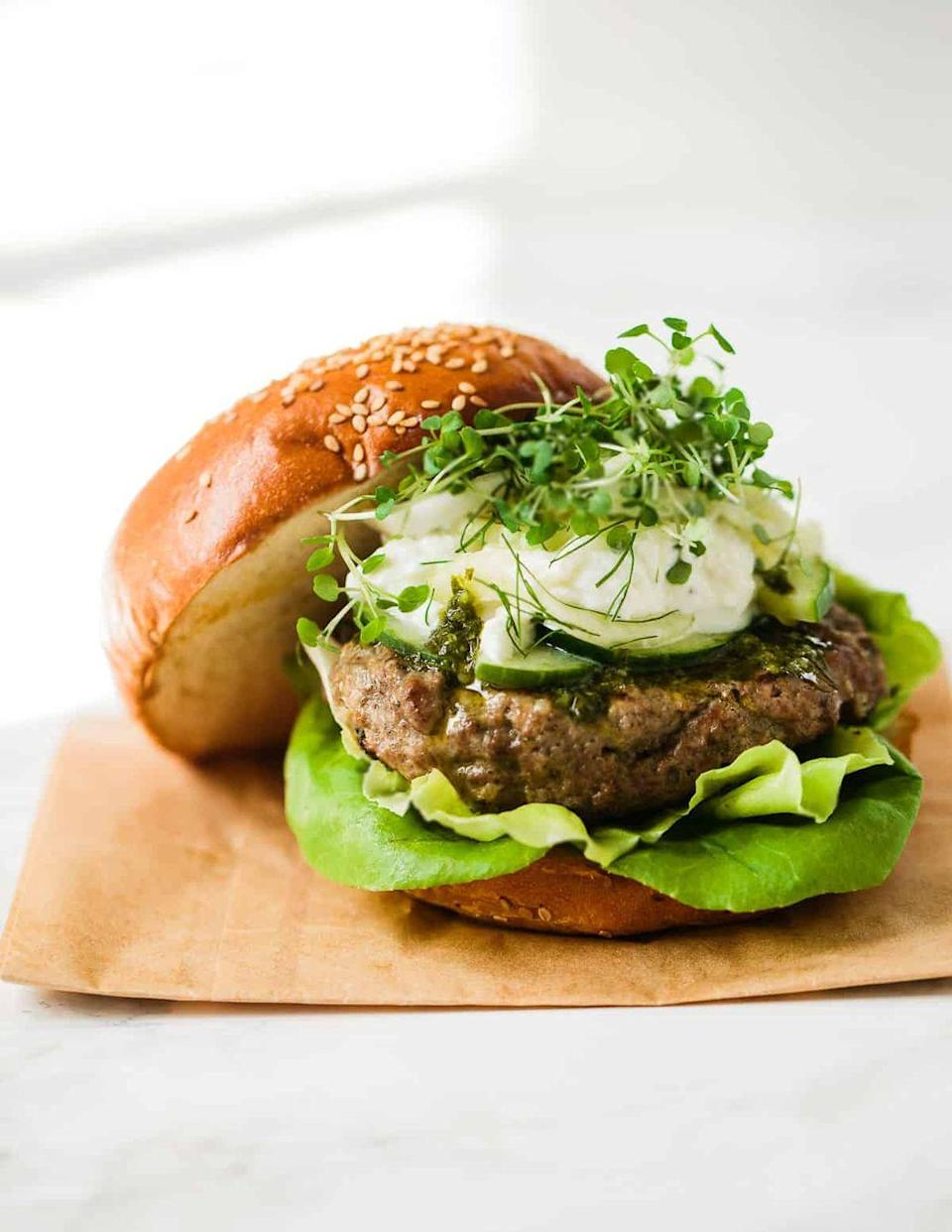 """<p>These lamb burgers are super juicy and flavourful, and they go great with the feta-yogurt sauce and fennel slaw.</p><p>Get the<a href=""""https://familystylefood.com/lamb-burgers-with-shawarma-spice/"""" rel=""""nofollow noopener"""" target=""""_blank"""" data-ylk=""""slk:Spiced Lamb Burgers With Fennel Slaw"""" class=""""link rapid-noclick-resp""""> Spiced Lamb Burgers With Fennel Slaw</a> recipe.</p><p>Recipe from <a href=""""https://familystylefood.com/"""" rel=""""nofollow noopener"""" target=""""_blank"""" data-ylk=""""slk:Family Style Food."""" class=""""link rapid-noclick-resp"""">Family Style Food.</a></p>"""