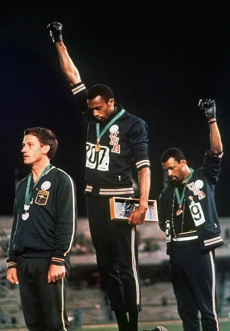 At the 1968 Olympics, U.S. athletes Tommie Smith, center, and John Carlos, right, protest. At left is Peter Norman.