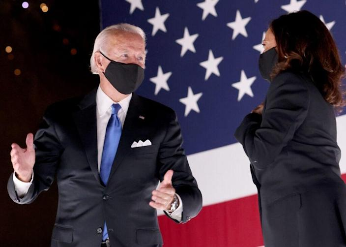 Democratic presidential nominee Joe Biden and Democratic Vice Presidential nominee Kamala Harris confer on stage outside the Chase Center after Biden delivered his acceptance speech on the fourth night of the Democratic National Convention from the Chase Center on August 20, 2020 in Wilmington, Delaware. (Photo by Win McNamee/Getty Images)