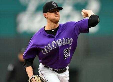FILE PHOTO: Apr 18, 2019; Denver, CO, USA; Colorado Rockies starting pitcher Kyle Freeland (21) delivers a pitch in the first inning against the Philadelphia Phillies at Coors Field. Mandatory Credit: Ron Chenoy-USA TODAY Sports
