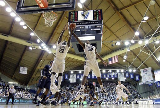 Villanova's JayVaughn Pinkston, left, and James Bell leap for a rebound during the first half of an NCAA college basketball game against Pittsburgh, Wednesday, Jan. 16, 2013, in Villanova, Pa. (AP Photo/Matt Slocum)