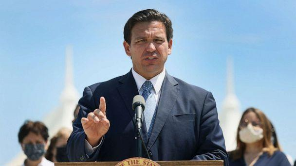 PHOTO: Florida Gov. Ron DeSantis speaks to the media about the cruise industry during a press conference, April 8, 2021, in Miami. (Joe Raedle/Getty Images)