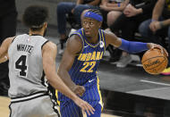 Indiana Pacers' Caris LeVert (22) drives against San Antonio Spurs' Derrick White during the second half of an NBA basketball game Saturday, April 3, 2021, in San Antonio. (AP Photo/Darren Abate)