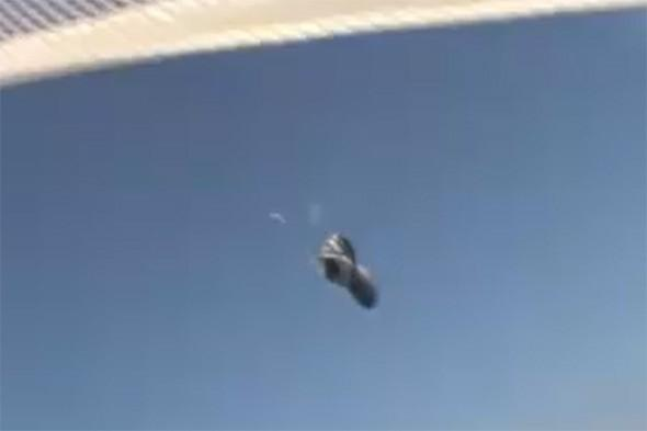 Video: Skydiver swoops down to catch falling shoe mid-air