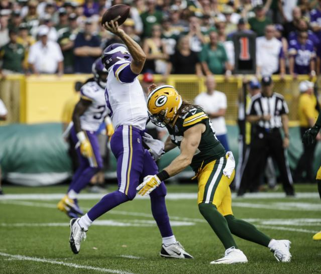 FILE - In this Sept. 16, 2018 file photo, Green Bay Packers' Clay Matthews is called for a roughing the passer penalty during the second half of an NFL football game against the Minnesota Vikings in Green Bay, Wis. The Packers were talking this week in practice about the rules and techniques to hit the quarterback. It's a sticky subject after officials called a roughing-the-passer penalty on Matthews last week. Coach Mike McCarthy says that he's confident in the way coaches teach how to tackle the quarterback. The Packers play the Redskins on Sunday, Sept. 23. (AP Photo/Mike Roemer, File)
