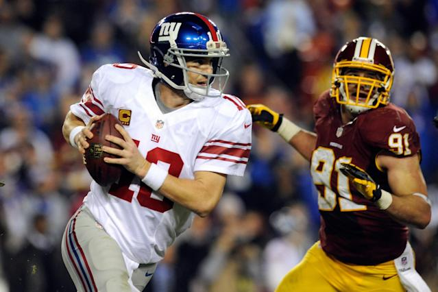 LANDOVER, MD - DECEMBER 03: Quarterback Eli Manning #10 of the New York Giants scrambles as he is being chased by Ryan Kerrigan #91 of the Washington Redskins in the third quarter against the Washington Redskins at FedExField on December 3, 2012 in Landover, Maryland. (Photo by Patrick McDermott/Getty Images)