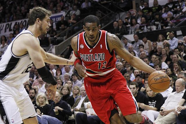 SAN ANTONIO, TX - MAY 14: LaMarcus Aldridge #12 of the Portland Trail Blazers drives around Tiago Splitter #22 of the San Antonio Spurs in Game Five of the Western Conference Semifinals during the 2014 NBA Playoffs at the AT&T Center on May 14, 2014 in San Antonio, Texas. (Photo by Chris Covatta/Getty Images)