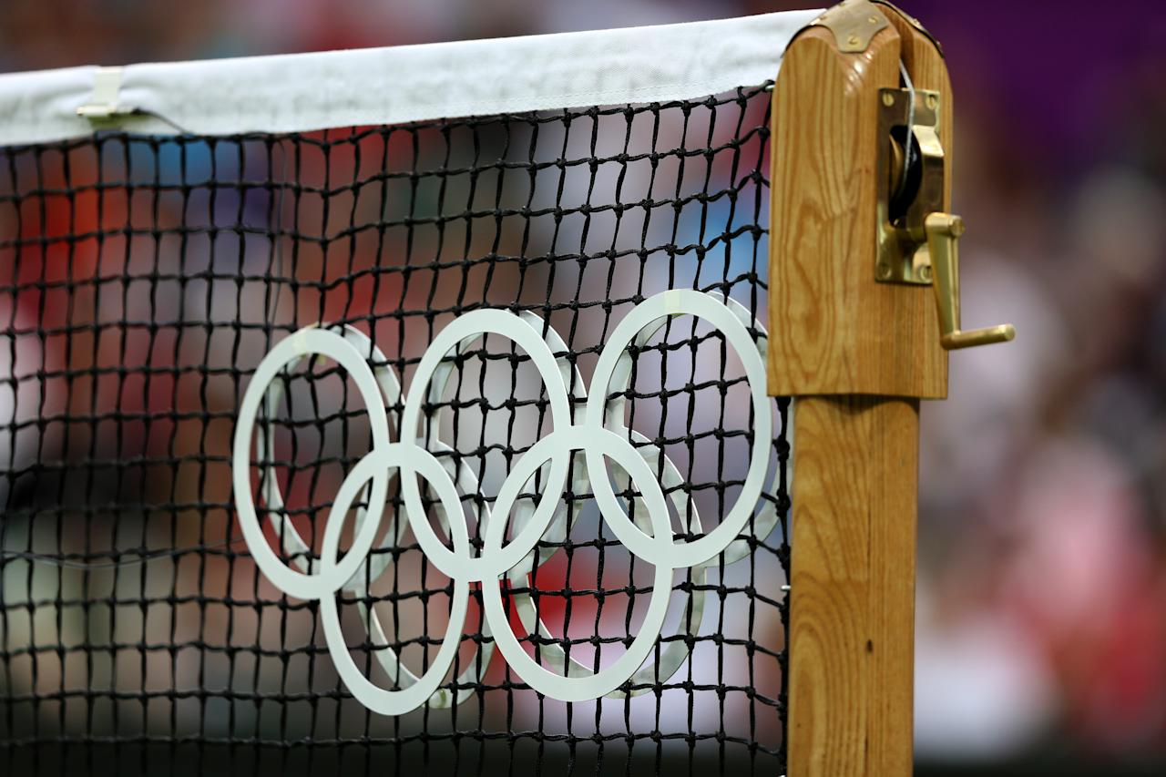 LONDON, ENGLAND - JULY 29:  A detail view of a tennis net displaying the Olympic rings on Day 2 of the London 2012 Olympic Games at the All England Lawn Tennis and Croquet Club in Wimbledon on July 29, 2012 in London, England.  (Photo by Clive Brunskill/Getty Images)