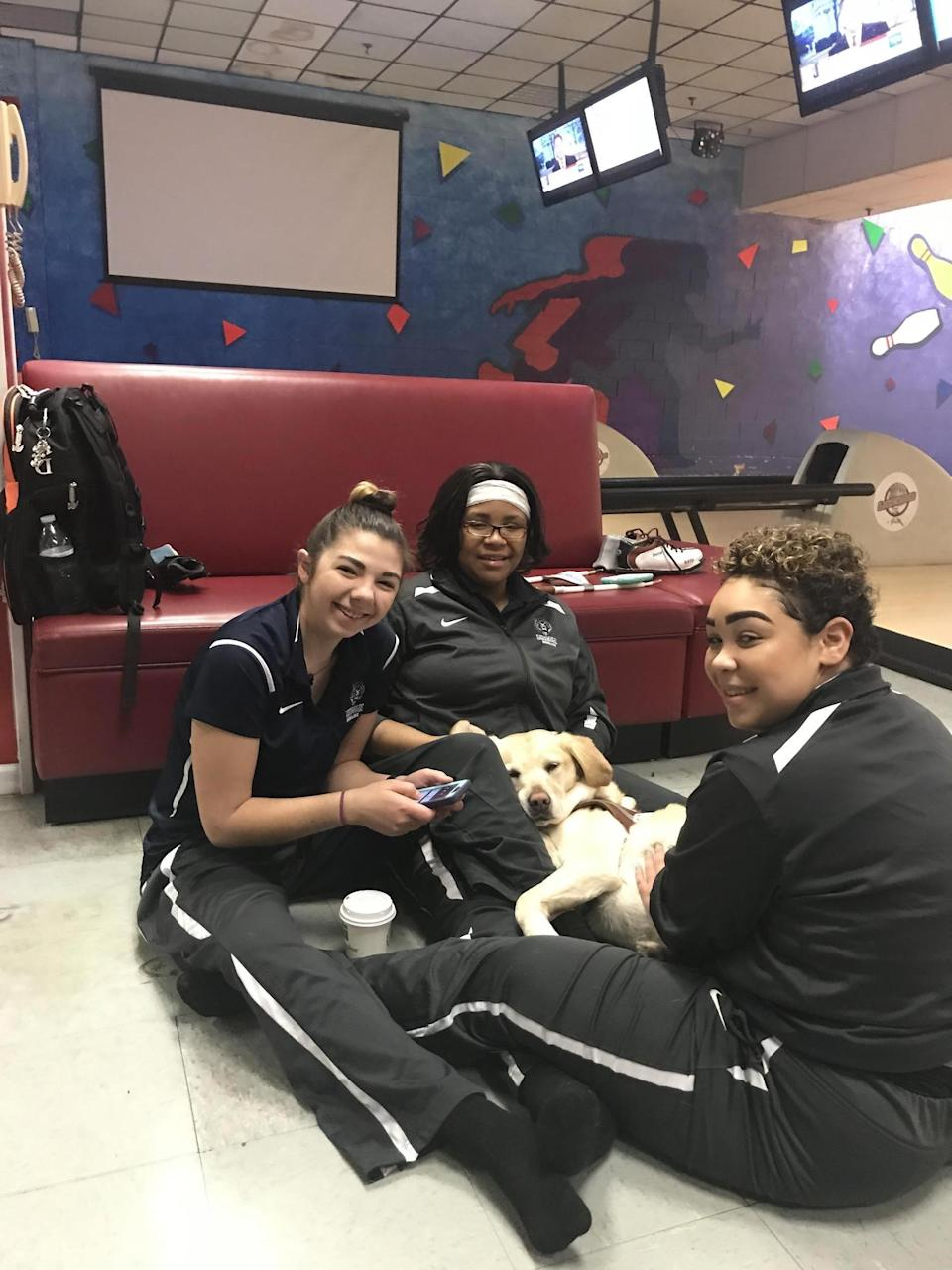 Petra, a golden retriever seeing-eye dog, was an honorary member of the Lincoln University women's bowling team before it was cut.