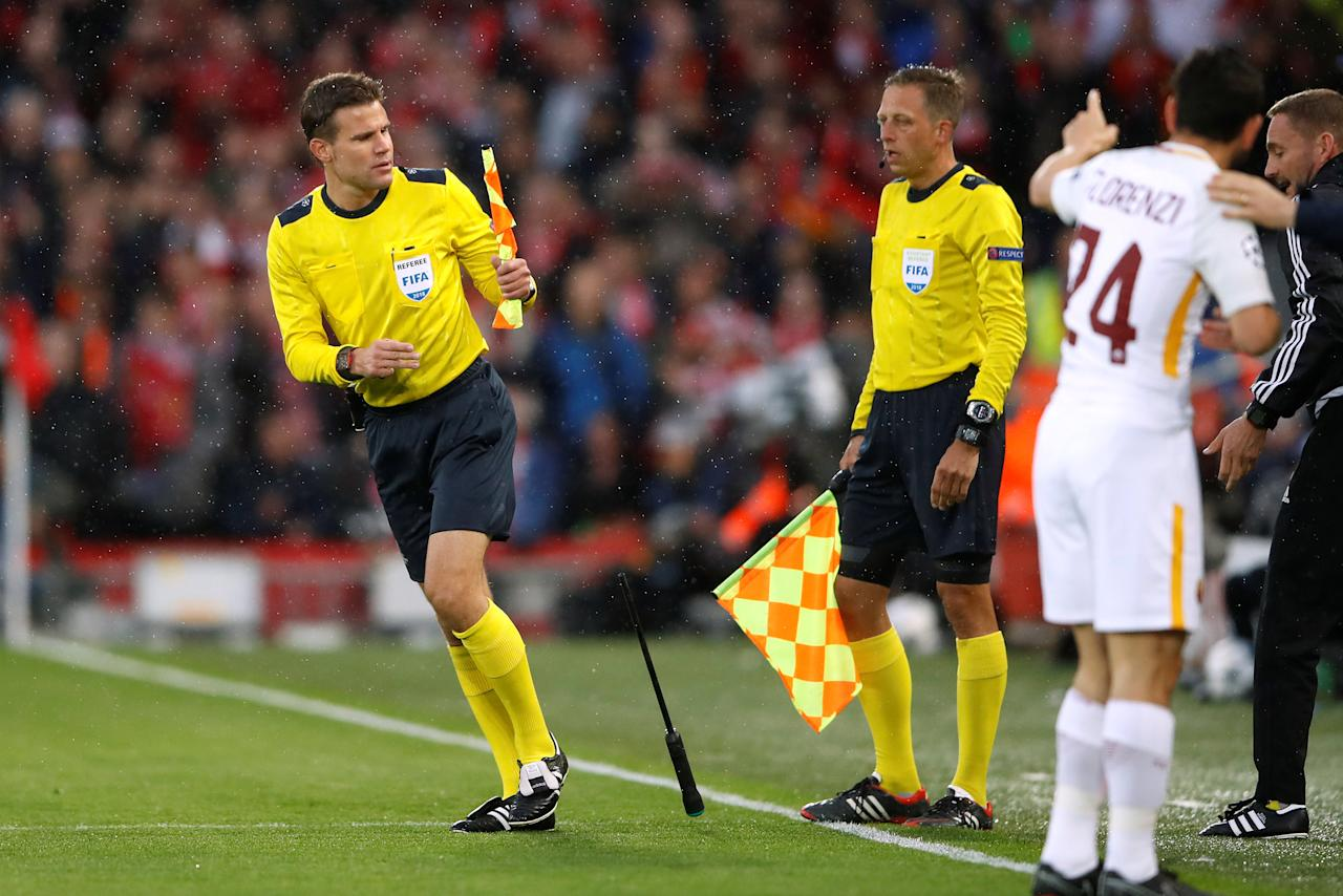Soccer Football - Champions League Semi Final First Leg - Liverpool vs AS Roma - Anfield, Liverpool, Britain - April 24, 2018   Referee Felix Brych with a broken flag      Action Images via Reuters/Carl Recine