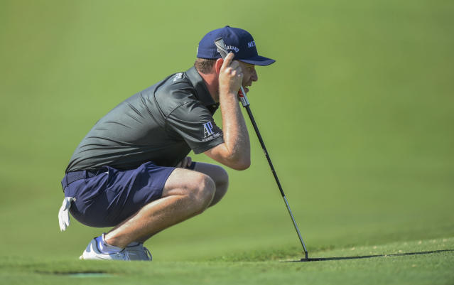 South Africa's Brandon Grace lines up a shot during play in the European Tour in Malelane, South Africa, Thursday, Nov. 28, 2019. Players have been allowed to wear shorts for the first time during tournament play because temperatures are expected to reach 40 degrees Celsius over the next few days. (AP Photo)