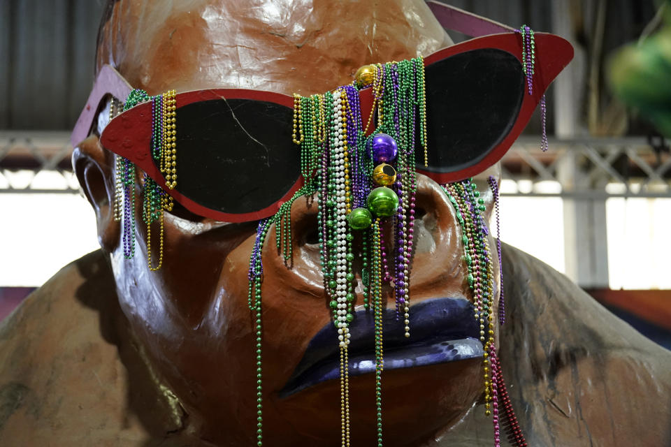 Beads hang from a float created by Kern Studios, inside Mardi Gras World in New Orleans, Friday, Feb. 12, 2021. New Orleans' annual pre-Lenten Mardi Gras celebration is muted this year because of the coronavirus pandemic. Parades canceled. Bars closed. Crowds suppressed. Mardi Gras joy is muted this year in New Orleans as authorities seek to stifle the coronavirus's spread. And it's a blow to the tradition-bound city's party-loving soul. (AP Photo/Gerald Herbert)