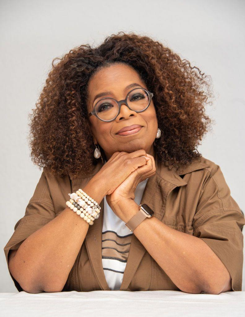 """<p>Here, Oprah's warm, coppery highlights are subtle enough to be considered more of a """"bronde,"""" a flattering fusion of brown and blonde. If you're contemplating lightening your hair, but aren't ready to take the full plunge, this is a safe, classic way to try something new.</p>"""